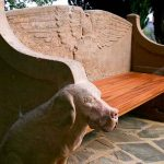 dog-shaped arm rests on the seat of remembrance