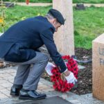 laying a wreath at the war memorial