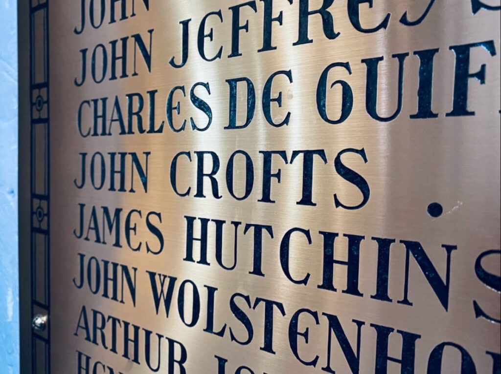 Brass plaque showing john crofts' name